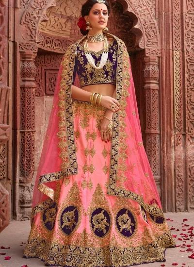 Peach and purple satin silk and net wedding lehenga