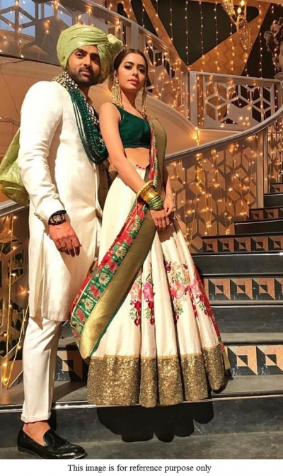 Bollywood model cream green and red crepe silk lehenga choli